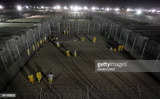 Iraqi detainees walk in a courtyard inside the Camp Bucca detention centrelocated near the KuwaitIraq border on May 19 2008 There are approximately...