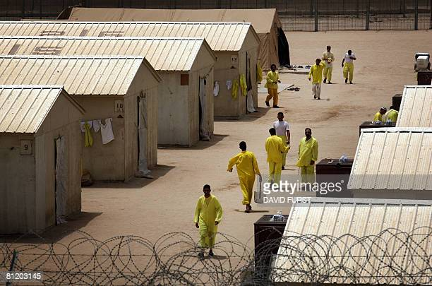 Iraqi detainees walk inside the Camp Bucca detention centre located near the KuwaitIraq border on May 20 2008 There are approximately 22000 detainees...