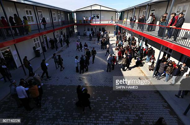 Iraqi displaced students who fled clashes between progovernment forces and Islamic State group jihadists stand outside their classrooms at the...
