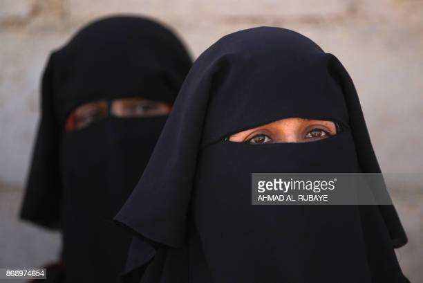 Iraqi displaced women from the outskirts of the city of alQaim on the border with Syria in western Anbar province gather in a safe place as Iraqi...
