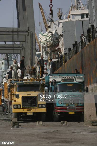 Iraqi dock workers unload lorries at the quay side at the port of Umm Qasr near Basra on October 16 2008 in Basra Iraq Business at the port has been...