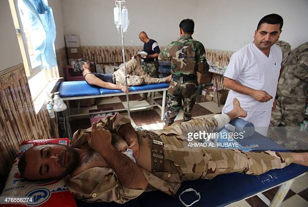 Iraqi doctors treat wounded soldiers at a field hospital in the town of Baiji north of Tikrit as allied Iraqi forces fight against the Islamic State...