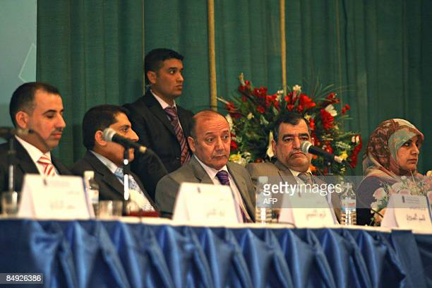 Iraqi election commission chief Faraj alHaydari smiles as he sits next to colleagues as the results of the provincial elections are read out during a...
