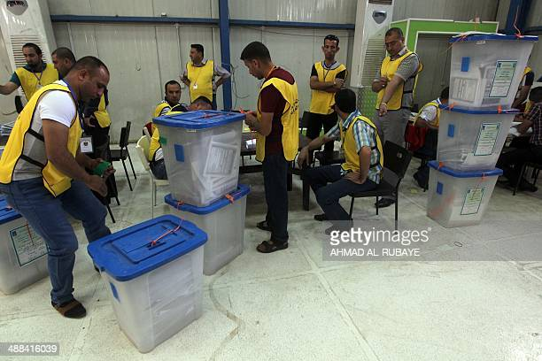 Iraqi election commission officials count votes ferried in from the western city of Ramadi at a polling station in the capital Baghdad on May 6...