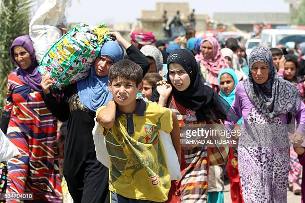 Iraqi families are pictured near alSejar village in Iraq's Anbar province after fleeing the city of Fallujah on May 27 during a major operation by...