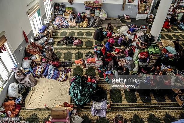Iraqi families fled from Geyyare district of Mosul due to attacks of Islamic State of Iraq and the Levant shelter in a mosque in Mosul's Dibege...