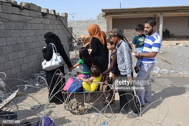 Iraqi families fleeing Islamic State group advance in their towns arrive to take refuge in a Kurdishcontrolled area in Mullah Abdullah some 25 kms...