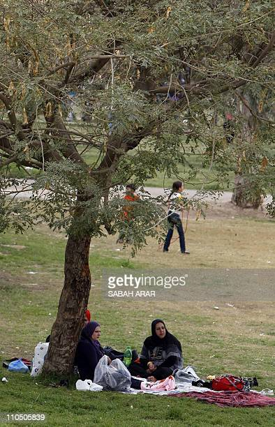 Iraqi families picnic at the Zawra Park in central Baghdad on March 21 2011 as they mark the Holiday of Noruz an ancient Persian festival celebrated...