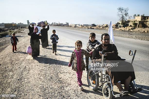 Iraqi families who fled the violence due to the ongoing operation by Iraqi forces to retake the city of Mosul from Islamic State group jihadists...