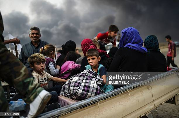 Iraqi families who were displaced by the ongoing operation by Iraqi forces against jihadists of the Islamic State group to retake the city of Mosul,...