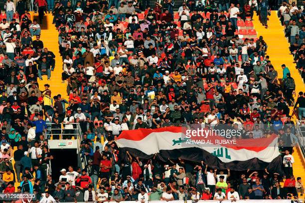 Iraqi fans cheer during the AFC champions league Group A football match between Iraq's Al Zawraa and UAE's Al Wasl at the Karbala Sports City stadium...