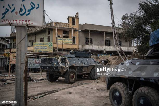 Iraqi federal police armoured personnel carriers are parked during the battle to recapture west Mosul on April 13 2017 in Mosul Iraq Despite being...