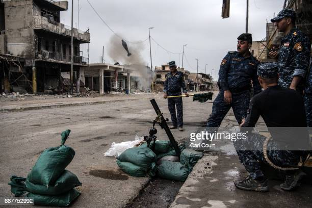Iraqi federal police fire a mortar at an Islamic State position during the battle to recapture west Mosul, on April 12, 2017 in Mosul, Iraq. Despite...