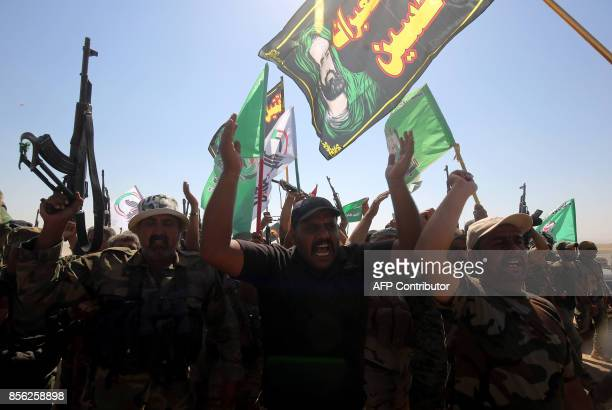 Iraqi fighters from the Hashed alShaabi take part in Ashura commemorations that mark the killing of Imam Hussein one of Shiite Islam's most revered...