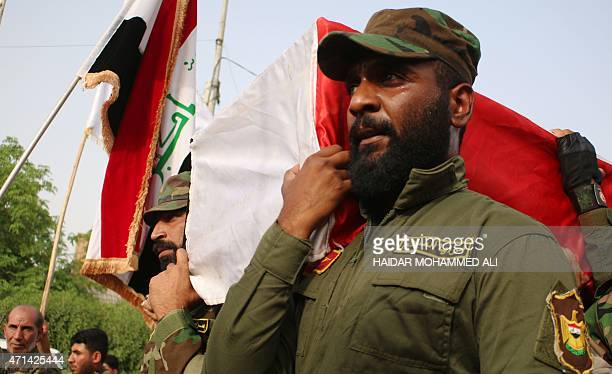Iraqi fighters from the Saraya al-Salam , a group formed by Iraqi Shiite Muslim cleric Moqtada al-Sadr, carry the coffin of a comrade, who died in...