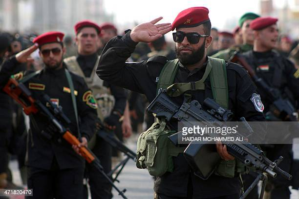 Iraqi fighters from the Saraya al-Salam , a group formed by Iraqi Shiite Muslim cleric Moqtada al-Sadr, salute during a military training in the...