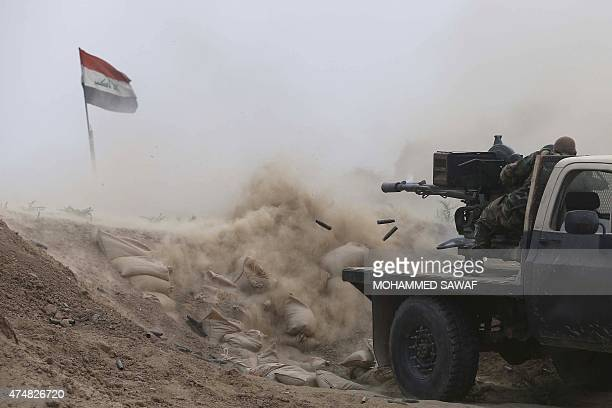Iraqi fighters from the Shiite Muslim AlAbbas popular mobilisation unit battle Islamic State jihadists in an area surrounding the village of Dujail...