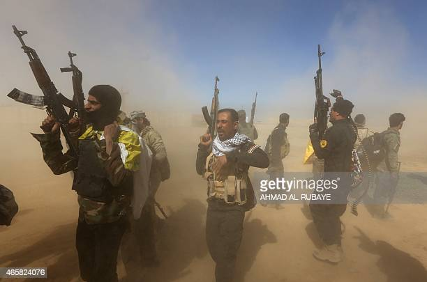 Iraqi fighters of the governmentcontrolled Popular Mobilisation units gather on the western entrance of the Iraqi city of Tikrit during a military...