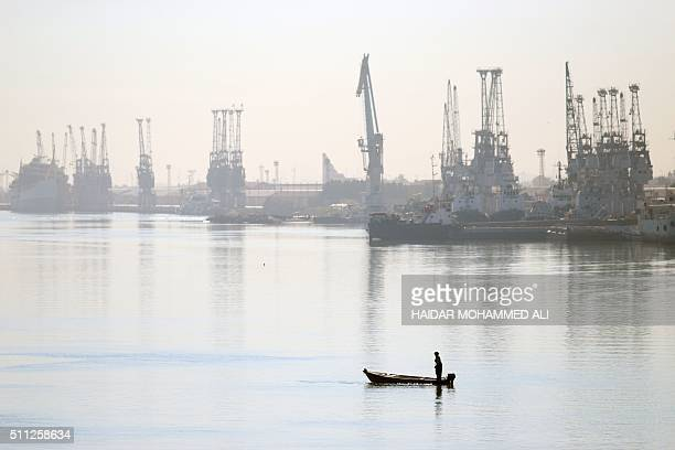Iraqi fisherman stands on his boat on the Shatt al-Arab water way in the southern city of Basra, some 600 kms from the capital Baghdad, on February...