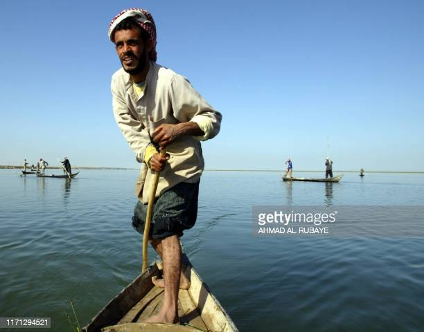 Iraqi fishermen ply their trade at a marsh near the village of alHamar outside the southern city of Nassiriya 16 January 2004 Now that fighting in...