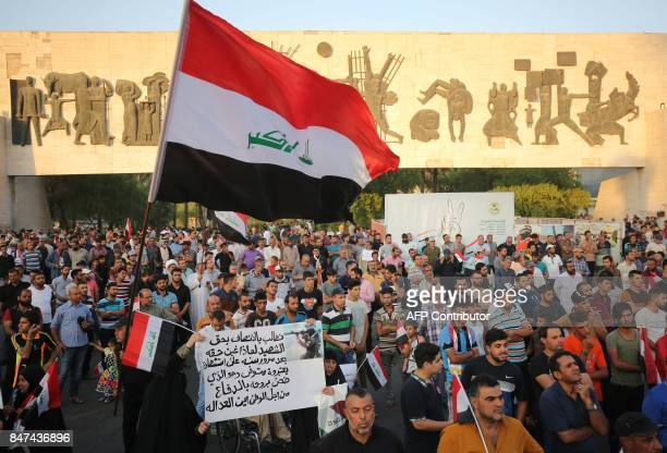 Iraqi followers of cleric Moqtada alSadr take part in a demonstration against corruption in Iraq and demanding reform and a change in the electoral...