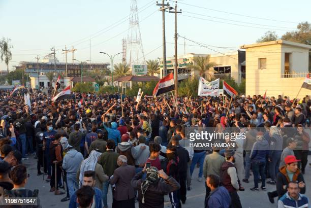 Iraqi followers of influential cleric Moqtada Sadr clash with antigovernment protesters during a demonstration in the central holy city of Najaf on...