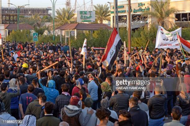 Iraqi followers of influential cleric Moqtada Sadr clash with protesters as they raid an antigovernment protest camp in the central holy city of...