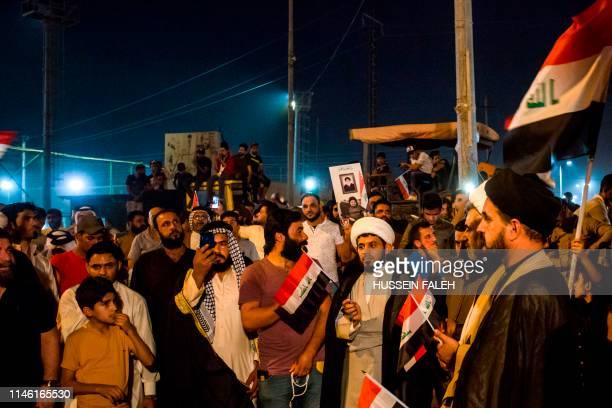 Iraqi followers of Shiite Muslim cleric Moqtada alSadr gather during a demonstration in the southern city of Basra on May 24 against involvement in...