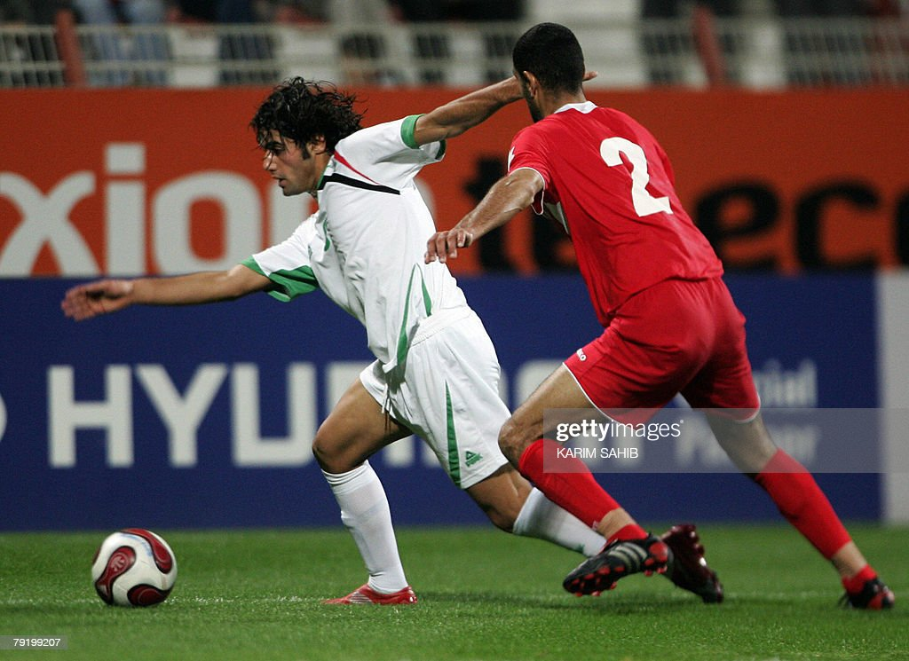 Iraqi football player Samir Said (L) fights for the ball against Jordan's Bassem Fathi during a friendly match between the two countries' national teams in Dubai 24 January 2008. The game ended in a 1-1 draw.