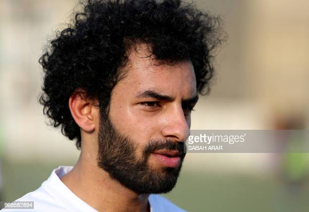 Iraqi footballer Hussein Ali who plays for the Iraqi AlZawraa FC and is a lookalike of Liverpool's Egyptian forward Mohamed Salah trains with his...