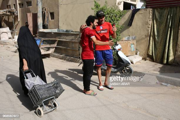 Iraqi footballer Hussein Ali who plays for the Iraqi AlZawraa FC and is a lookalike of Liverpool's Egyptian forward Mohamed Salah poses for pictures...