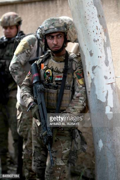 Iraqi forces advance through Mosul's Jawasaq neighbourhood on February 27 during an offensive to retake the area from Islamic State group fighters...