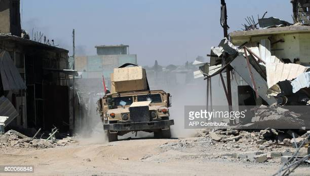 Iraqi forces advance through the Old City of Mosul on June 27 as the offensive continues to retake the last district held by the Islamic State group...