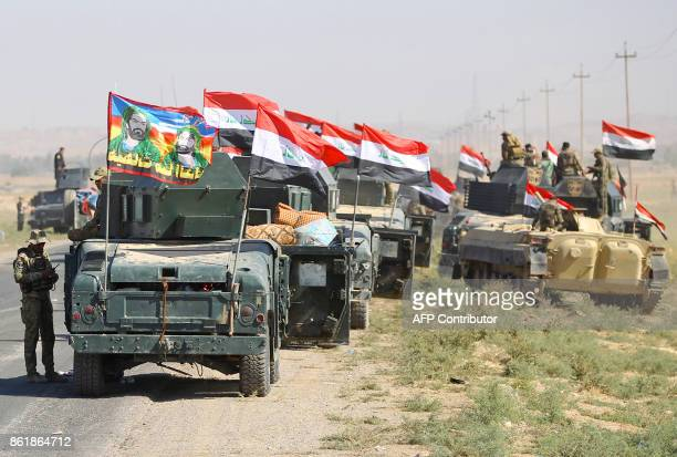 Iraqi forces advance towards the city of Kirkuk during an operation against Kurdish fighters on October 16 2017 Iraqi forces clashed with Kurdish...