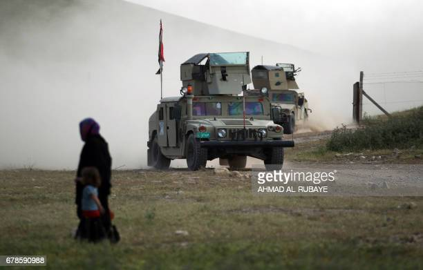 Iraqi forces advance towards the northwestern Mosul neighbourhood of Musharifah, on May 4 during an ongoing government offensive against Islamic...