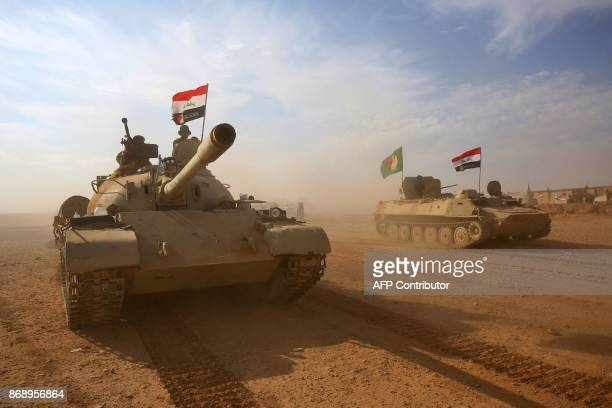 Iraqi forces and Hashed al-Shaabi advance towards the city of al-Qaim, in western Anbar province, on the Syrian border as they fight against remnant...
