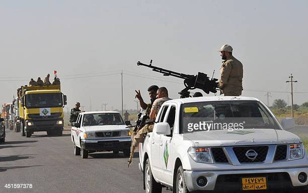 Iraqi forces and mainly Shiite Muslim volunteers arrive in the predominantlySunni Muslim city of Samarra 124 kms from Baghdad on July 2 to protect...