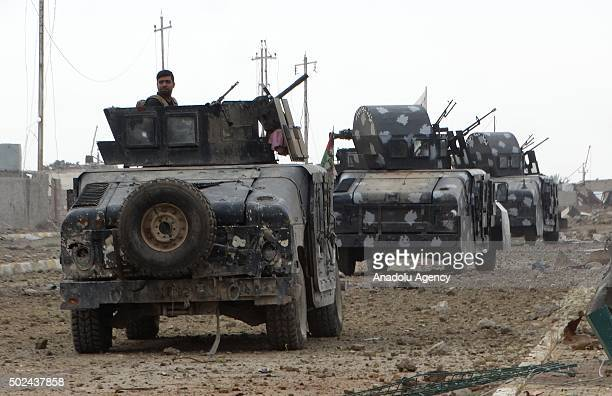 Iraqi forces are seen during an operation aiming to reseize the Ramadi from Daesh terrorist in alDubat neighborhood of Ramadi Iraq on December 24 2015