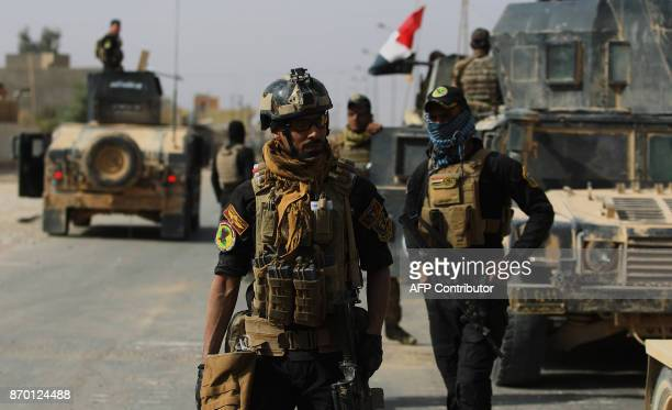 Iraqi forces are seen on November 4 2017 in the centre of the city of alQaim in Iraq's western Anbar province near the Syrian border after retaking...