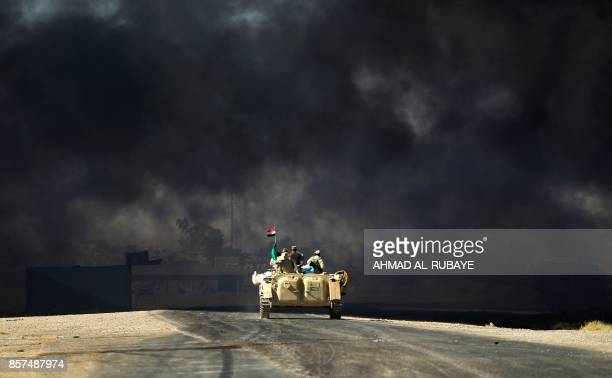 Iraqi forces backed by fighters from the Hashed alShaabi advance towards the Islamic State group's stronghold of Hawija on October 4 during an...