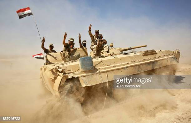 Iraqi forces backed by the Hashed Al-Shaabi advance towards the town of Tal Afar, west of Mosul, after the Iraqi government announced the beginning...