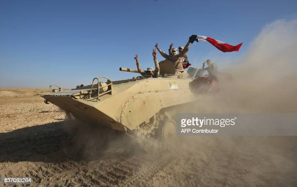 TOPSHOT Iraqi forces backed by the Hashed AlShaabi advance towards the town of Tal Afar west of Mosul after the Iraqi government announced the...