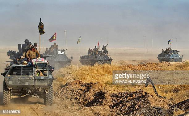 Iraqi forces deploy in the area of alShourah some 45 kms south of Mosul as they advance towards the city to retake it from the Islamic State group...