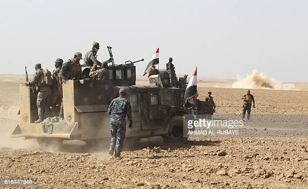 Iraqi forces deploy in the Bajwaniyah village about 30 kms south of Mosul on October 18 2016 after they liberated it from Islamic State group...