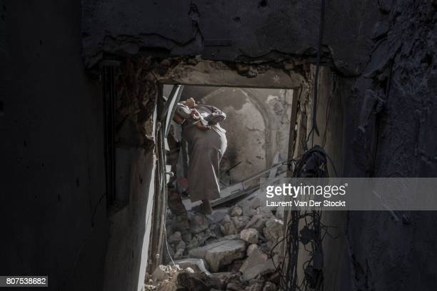 Iraqi forces detain a man they suspect of being affiliated with the Islamic State in al-Nuri mosque complex on June 29 in Mosul, Iraq. The Iraqi...
