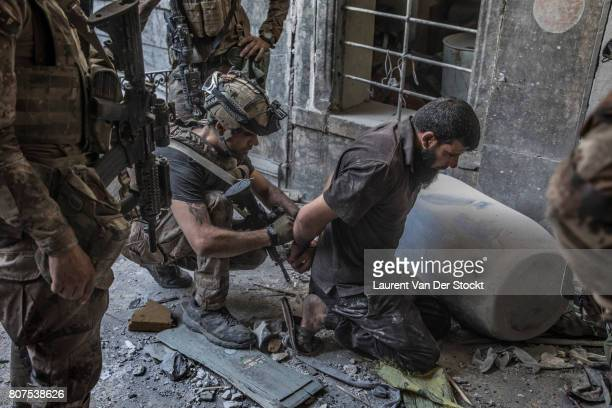 Iraqi forces discover a man they suspect of being affiliated with the Islamic State in alNuri mosque complex on June 29 in Mosul Iraq The Iraqi Army...