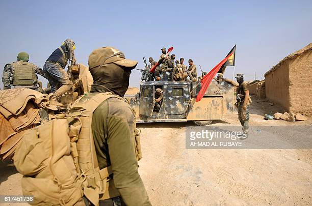 Iraqi forces enter the village of alKhuwayn south of Mosul after recapturing it from Islamic State group jihadists on October 23 in part of an...