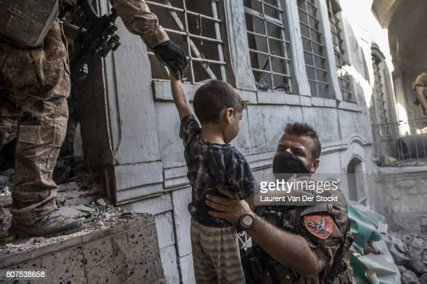 Iraqi forces evacuate a boy and his family they discovered in alNuri mosque complex on June 29 in Mosul Iraq The Iraqi Army Special Operations Forces...