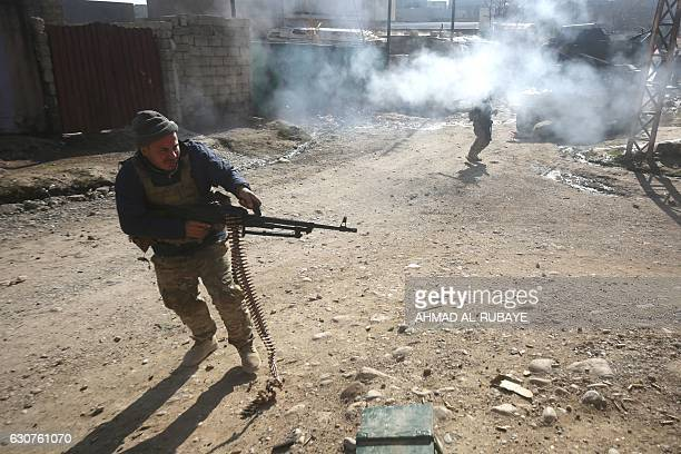 Iraqi forces fire against Islamic State group jihadists during an ongoing military operation in the Al-Intisar area in eastern Mosul, on January 1,...