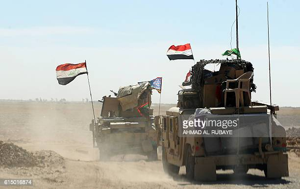 TOPSHOT Iraqi forces gather at the Qayyarah military base about 60 kilometres south of Mosul on October 16 as they prepare for an offensive to retake...